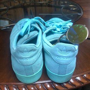 Turquoise adidas superstars